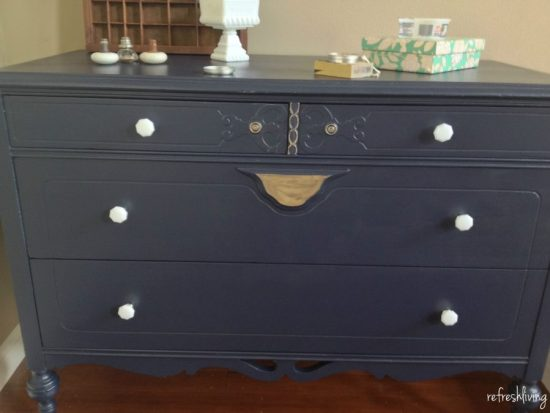 blue dresser with gold