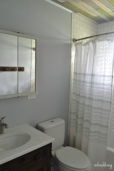 bathroom with barn wood ceiling