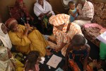 Here, Zarinah can be seen (in the gold) hosting a dream party for girls she sponsors in Sierra Leone.