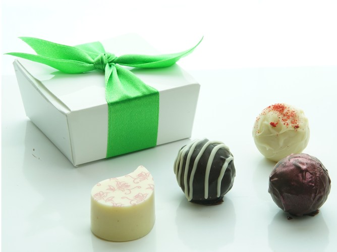 Our very own handmade chocolates, selected by you from our collection, and presented in personalised boxes with your choice of colour scheme and embellishment if you wish.