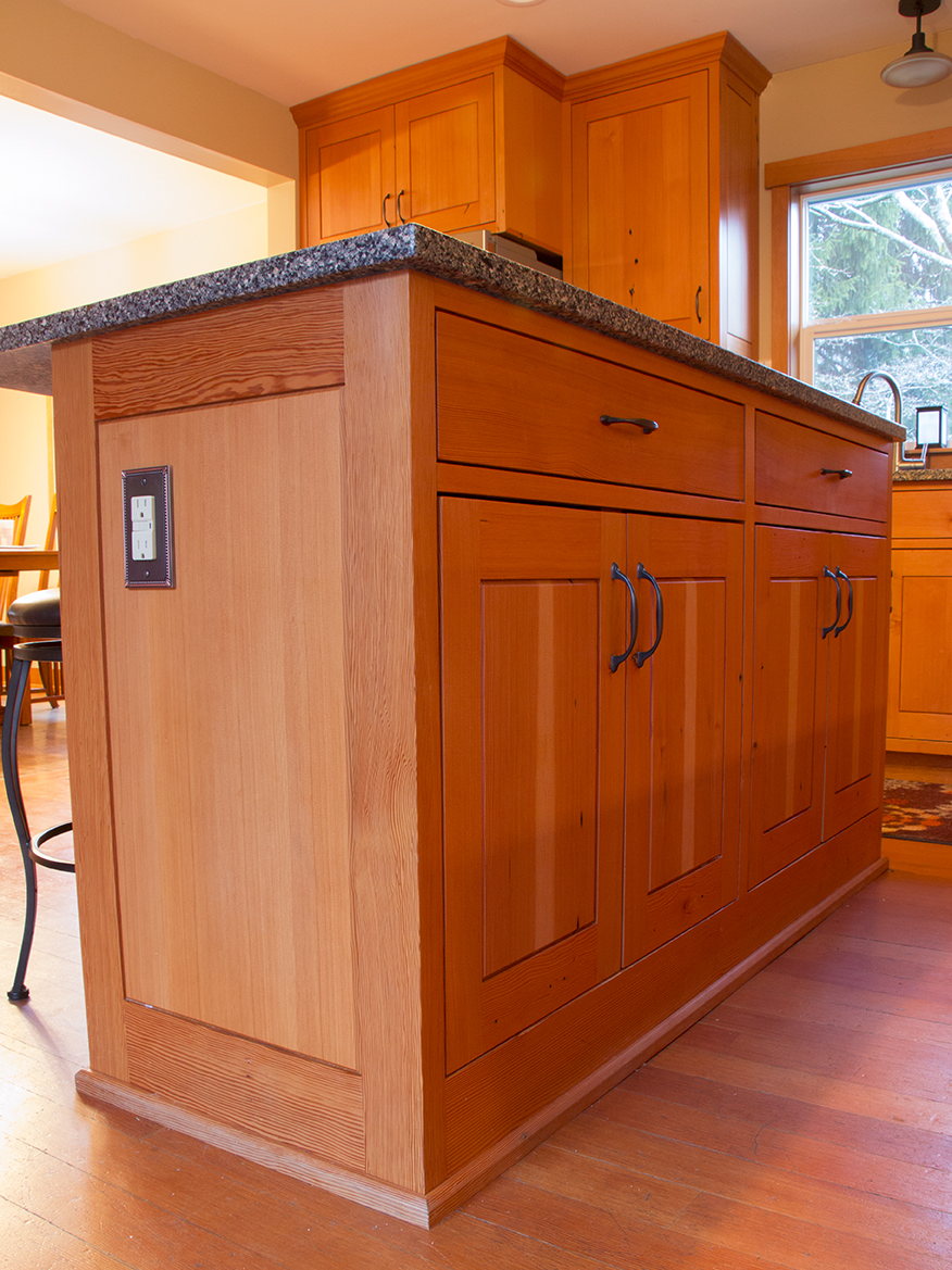 Small size kitchen island with power outlet. No recessed toe kick ...