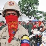 El grupo de milicianos que desfilo el 13 de Abril y que más llamo la atención por tener la cara tapada, sus gritos y mostrar su armamento.