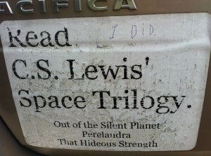 Our custom CS Lewis bumper sticker, urging all motorists to read his Space Trilogy.
