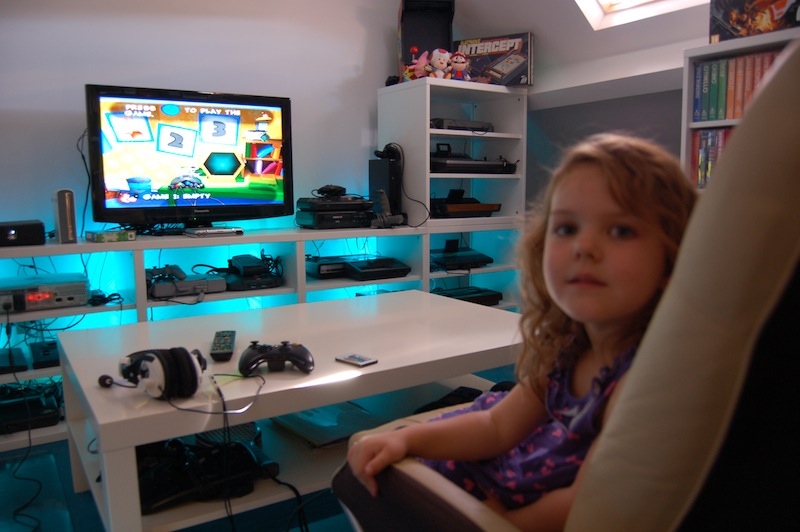 My daughter enjoying the Games Room. 23 consoles on permanent set up means a lot of choice, but also a lot of cables...