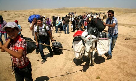 Syrian-refugees-flee-to-I-010