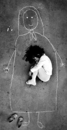 Iraqi-orphan-seeking-comfort-Facebook-233x450