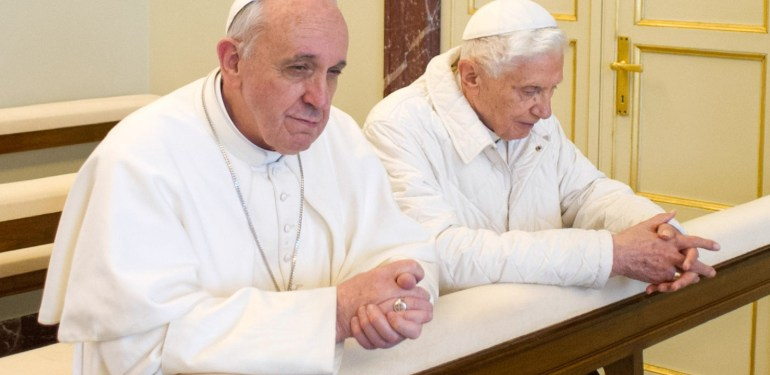 "This handout picture released by the Vatican press office on March 23, 2013 shows ""pope emeritus"" Benedict XVI (R) and Pope Francis praying in Castel Gandolfo. Pope Francis prepared to go face to face with his predecessor Benedict XVI on Saturday in a historic meeting between two men with very different styles but important core similarities.  AFP PHOTO / OSSERVATORE ROMANO/HO   RESTRICTED TO EDITORIAL USE - MANDATORY CREDIT ""AFP PHOTO / OSSERVATORE ROMANO"" - NO MARKETING NO ADVERTISING CAMPAIGNS - DISTRIBUTED AS A SERVICE TO CLIENTS"
