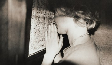 Mid Adult Woman in a Confessional