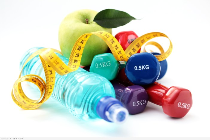 dumbbells and apple
