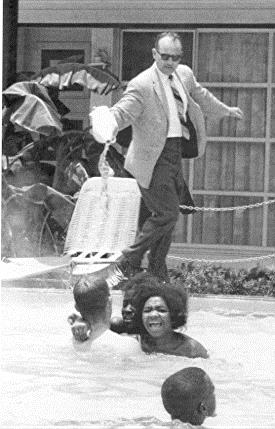 Hotel owner pouring acid in the water when black people  swam in his pool, ca. 1964