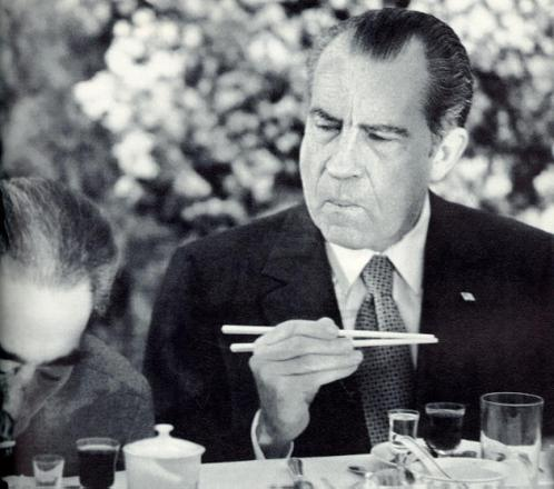 President Richard Nixon trying to use chopsticks while  visiting China in 1972
