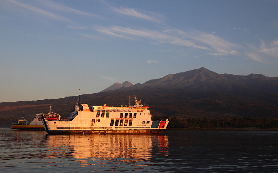 Ferry in Labuan Lombok harbour, East Lombok. Rinjani volcano in the background.