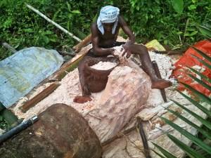 Asmat tribesperson harvesting sago