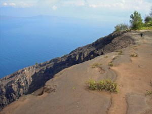 Standing at the edge of Mt Iya volcano crater rim