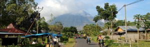 Locals live in the shadow of active Mt Inerie volcano, central , Indonesia