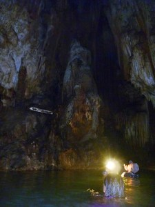 Wading through the underground river in Embultuk Cave, Java