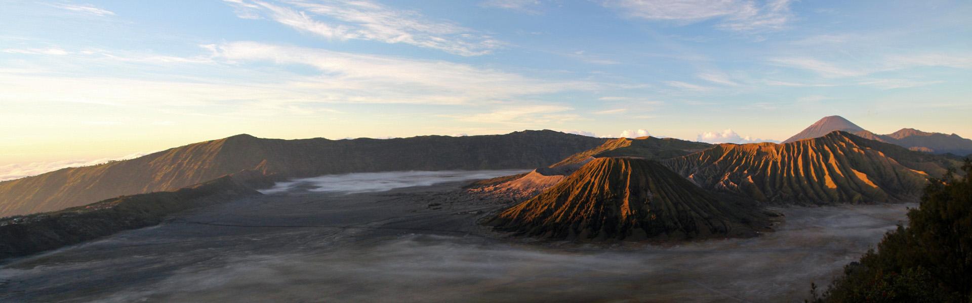 Sunrise over Mt Bromo crater, Mt Semeru in background