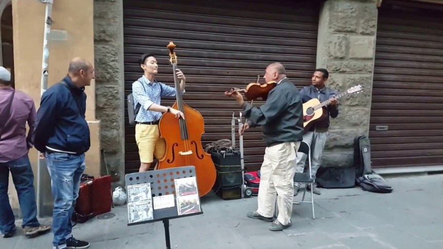 Korean tourist politely asks Italian street musicians if he can join them, absolutely kills it