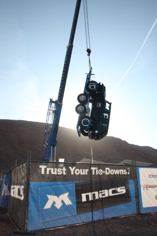 Macs Hanging Jeep 319x480 TRUST YOUR TIE DOWNS? MAC'S PUTS ITS STRAPS TO THE TEST