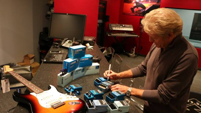 Don Felder signs Roland and BOSS gear backstage at 2nd Light Up the Blues Concert