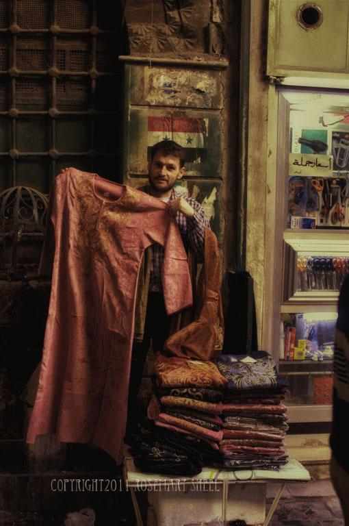 Caftan salesman in the Aleppo souk