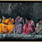 women dressed in sarees engaged in conversation