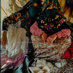 Berber girls dressed in their best pose in the family tent