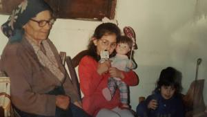 With Nonna Panetta. The cute one in the middle's my sister; I'm the one licking what I can only assume is Nutella (or grappa) off my lips!