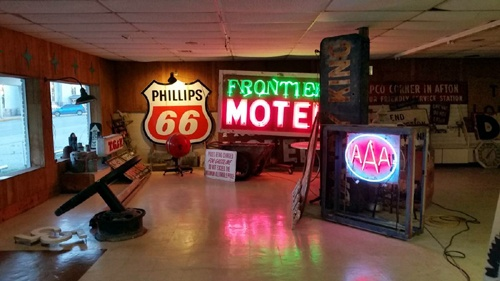 Building with vintage sign collection is for sale
