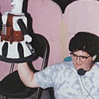 Rare photo of Josh Weinstein with Tom Servo, filming one of the theater segments, during season 1 of MST3k.
