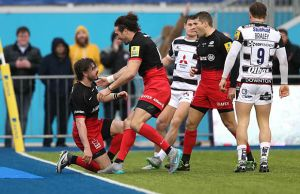 Ben Ransom celebrates scoring a try for Saracens
