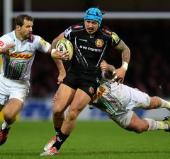 Jack Nowell tries to slip past Nick Evans