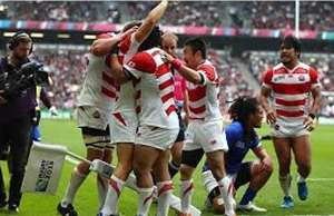 Japan celebrate victory over Samoa