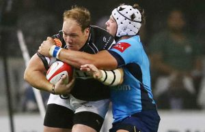 Lappies Labuschagne tackles Kyle Cooper of the Sharks