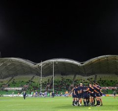 Melbourne Rebels gather in a huddle before a match