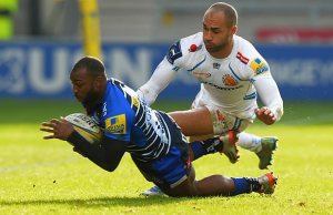 Neville Edwards of Sale Sharks tackled by Olly Woodburn