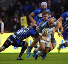Nili Latu of Newcastle Falcons is tackled by during Magnus Lund and Dan Braid