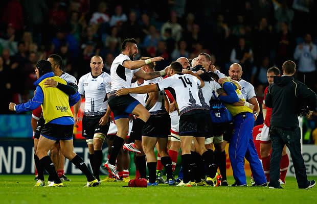 Romania celebrate victory over Canada