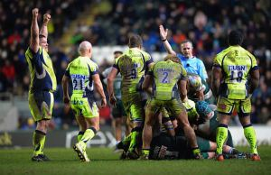 Referee Tim Wigglesworth blows the whistle for full time
