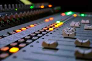 Close up of faders on a mixing board in the best recording studio in boston
