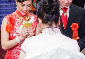 chinese wedding tea ceremony bride and groom receiving lucky money from aunt