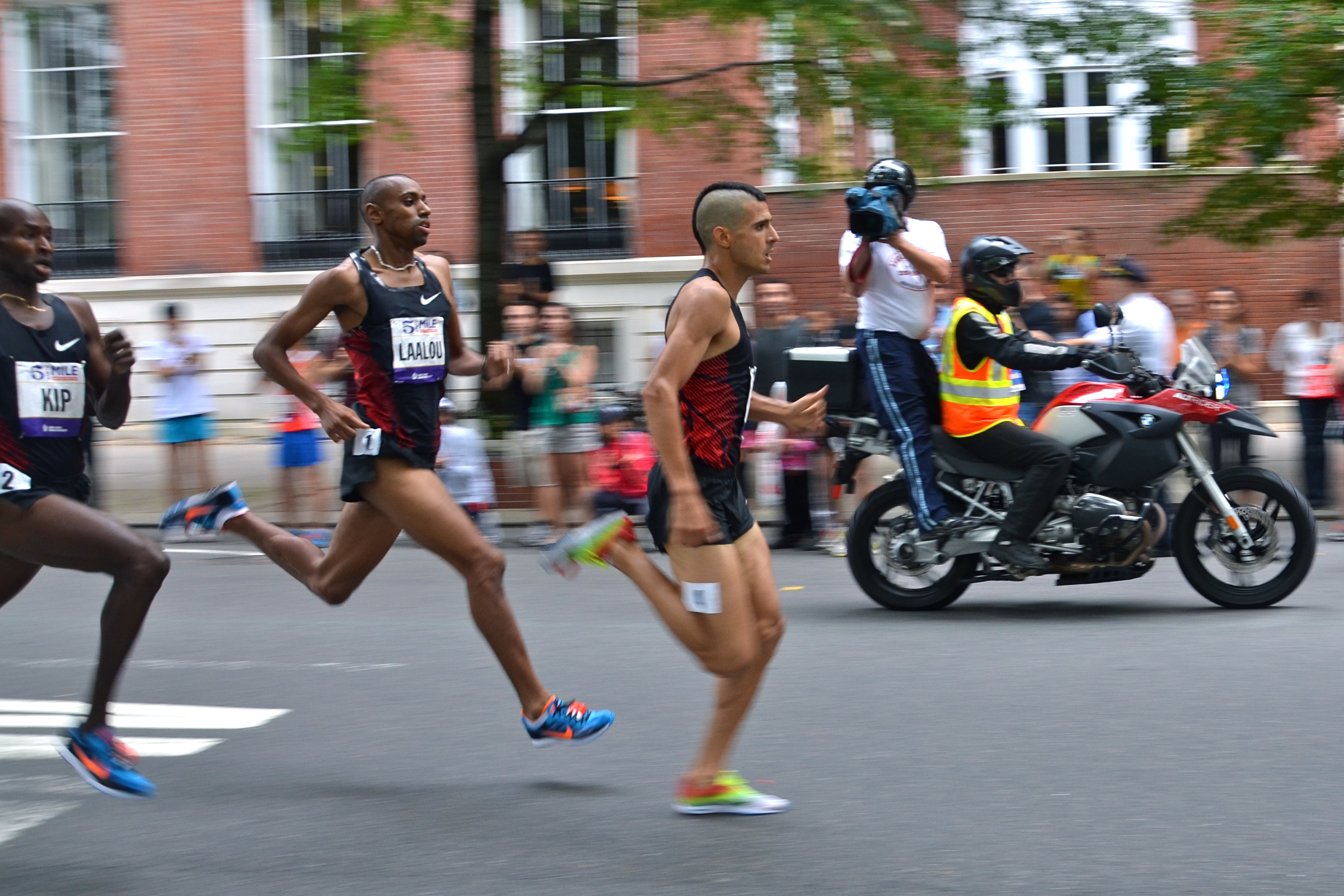 Lagat kicks, chasing down Laalou and Torrence