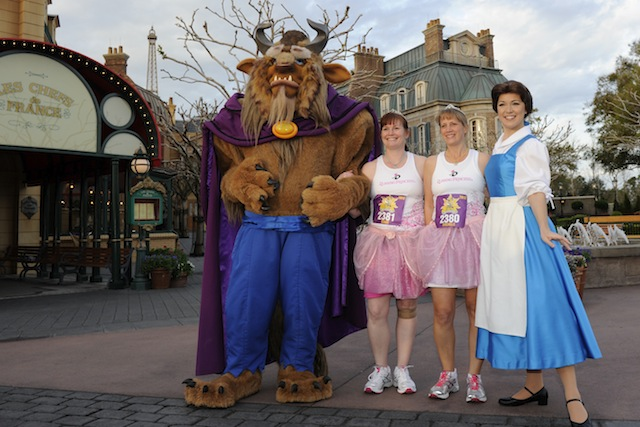 Runners pose with Belle and the Beast