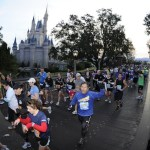 Runners charge past Cinderella Castle at the Walt Disney World Marathon. (Photo: runDisney)