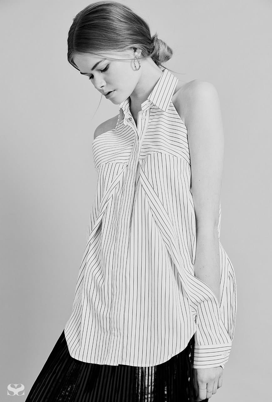 DION LEE shirt; EMPORIO ARMANI skirt; LUCY FOLK rings (worn throughout).