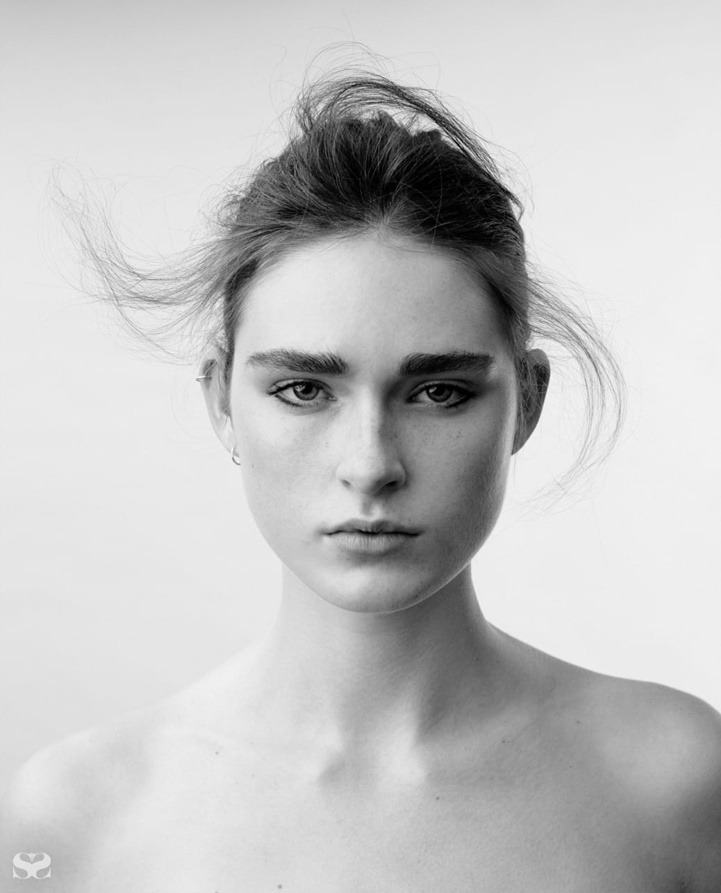 Model's own earrings (worn throughout).