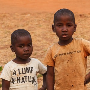 Children wearing T shirts with slogans