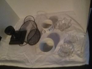 A candlestick holder, desktop basket, glass dishescandle holders, tea cups, and desertcreme brulee dishes