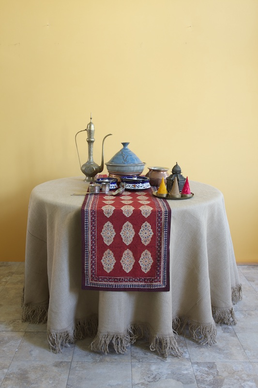 Red moroccan table runner on round table