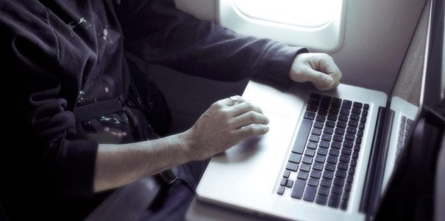 Playing on laptop on an airplane